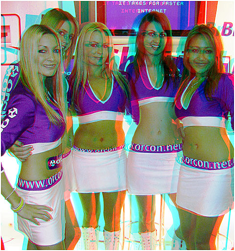 Janine on the left with the Orcon girls, was judged 'Hottest Promo Babe' and went to Bathhurst with Team Kiwi Racing. 3-D Photography by Marc Dawson.