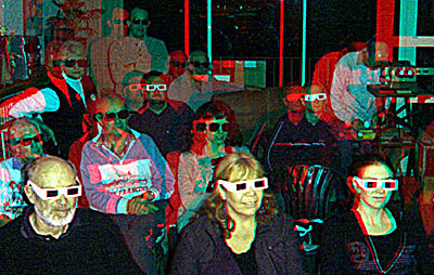Members of the New Zealand Stereoscopic Society viewing polarised slides with polarised glasses